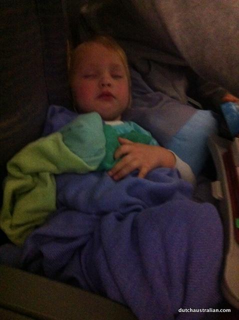 toddler sleeping on plane