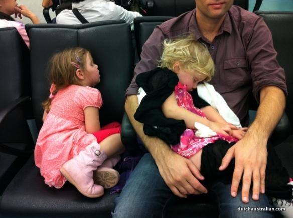 sleeping girls at airport