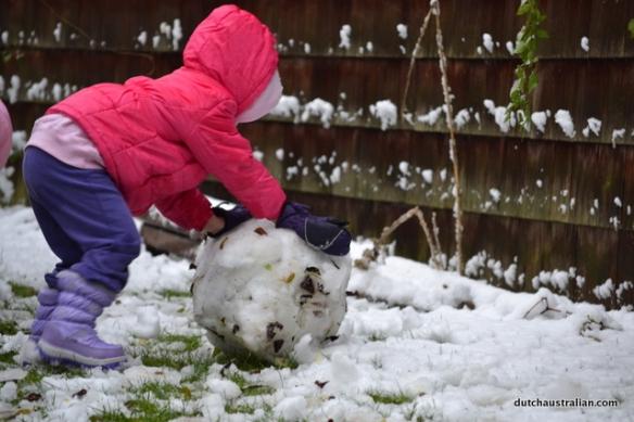 Isabella making snowball