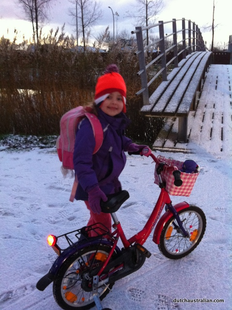 sophia and bike in snow
